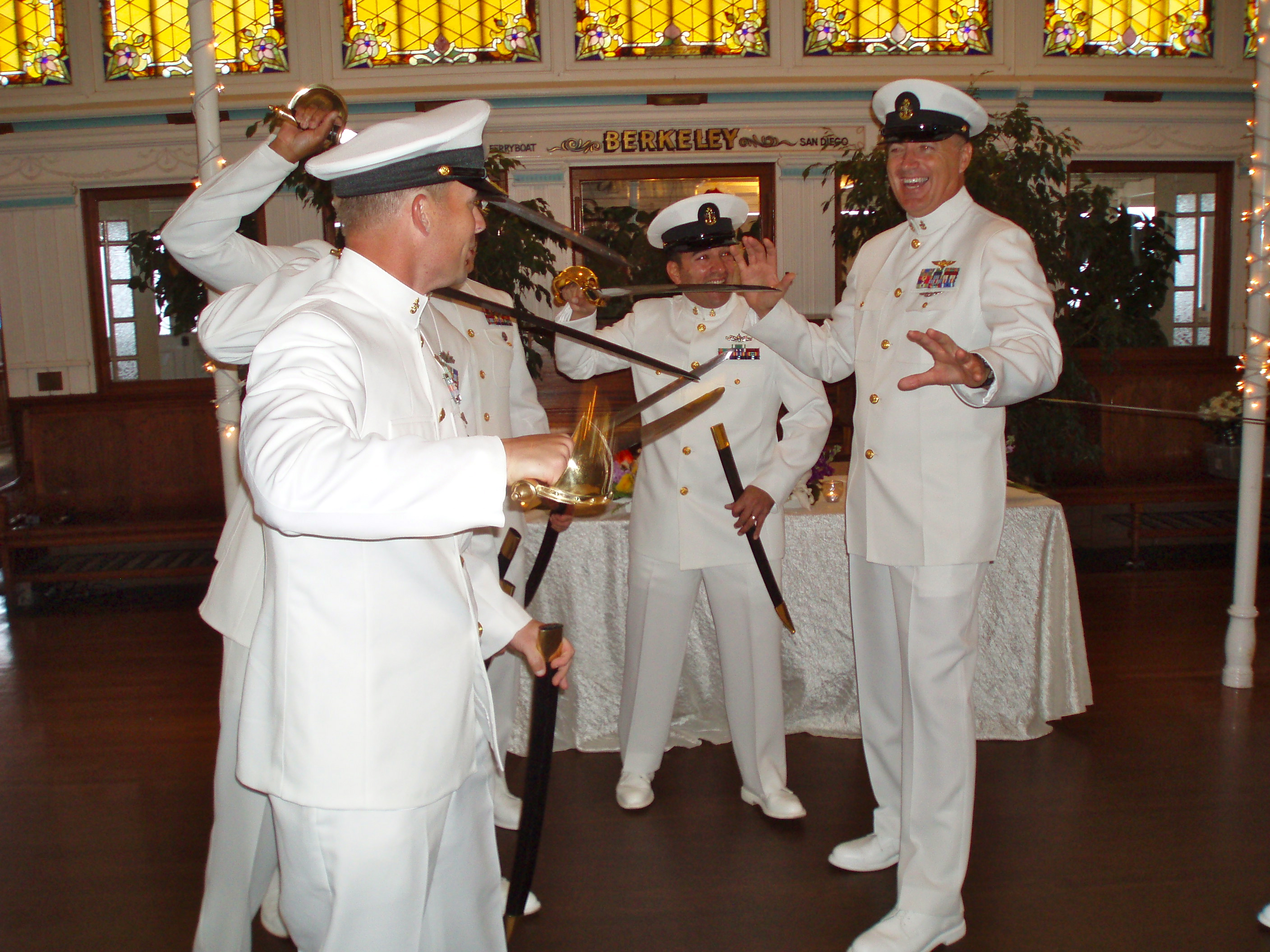 The groomsmen in Navy uniform practiced their sword arch and chatted with
